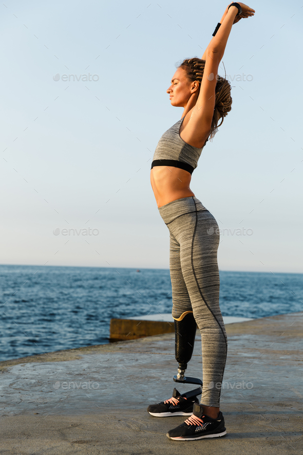 Full length of concentrated disabled athlete woman - Stock Photo - Images