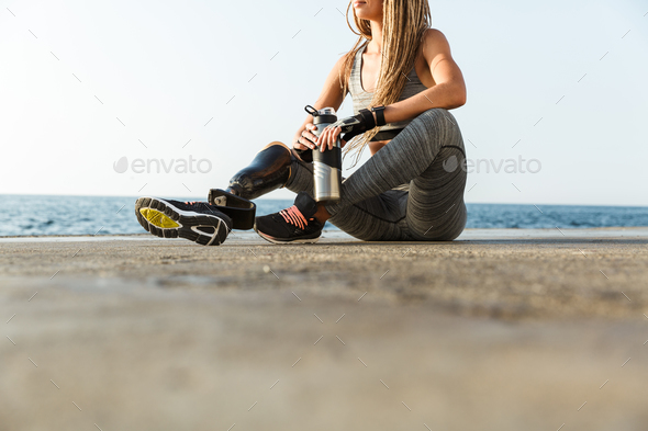 Cropped image of disabled athlete woman - Stock Photo - Images