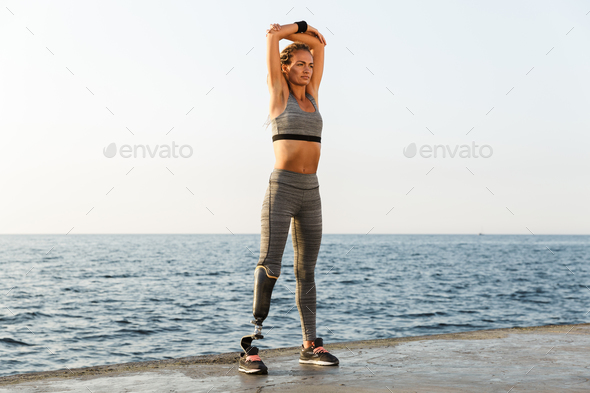 Full length of confident disabled athlete woman - Stock Photo - Images