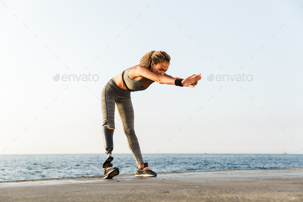 Full length of focused disabled athlete woman - Stock Photo - Images