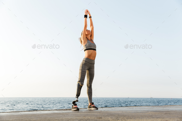 Full length of young disabled athlete woman - Stock Photo - Images