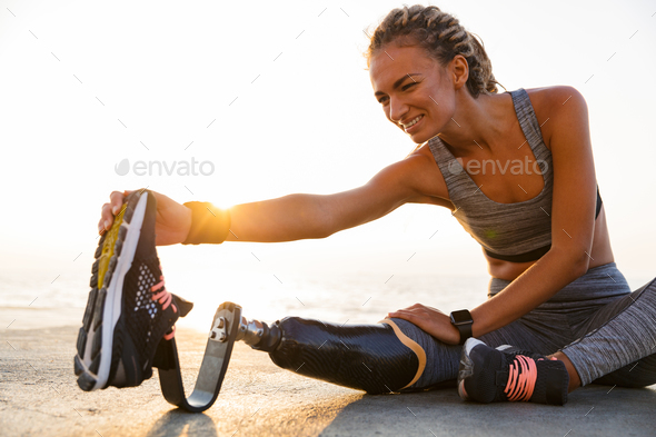 Cropped image of smiling disabled athlete woman - Stock Photo - Images