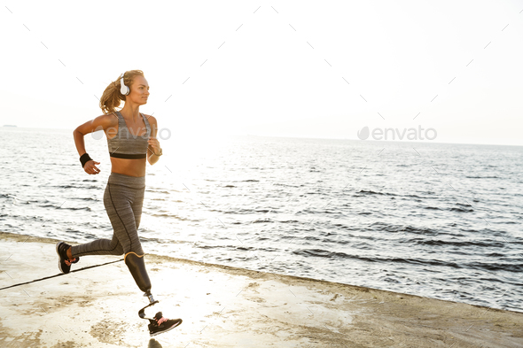 Amazing disabled sports woman running - Stock Photo - Images
