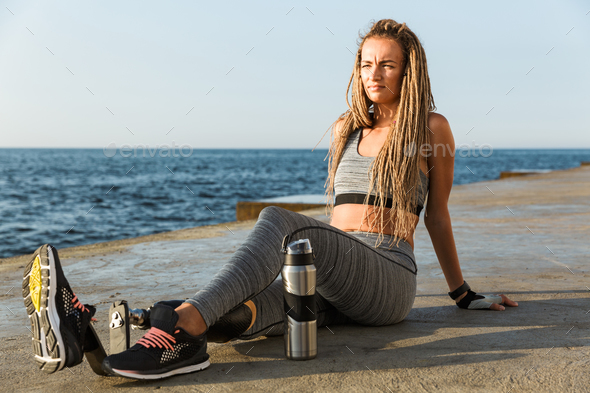 Attractive disabled athlete woman with prosthetic leg - Stock Photo - Images