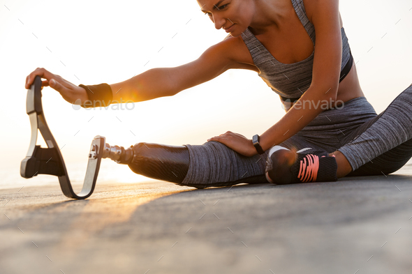 Cropped image of motivated disabled athlete woman - Stock Photo - Images