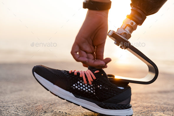 Close up of disabled athlete woman with prosthetic leg - Stock Photo - Images