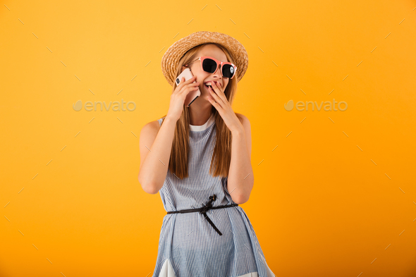 Portrait of a laughing young blonde woman in summer hat - Stock Photo - Images