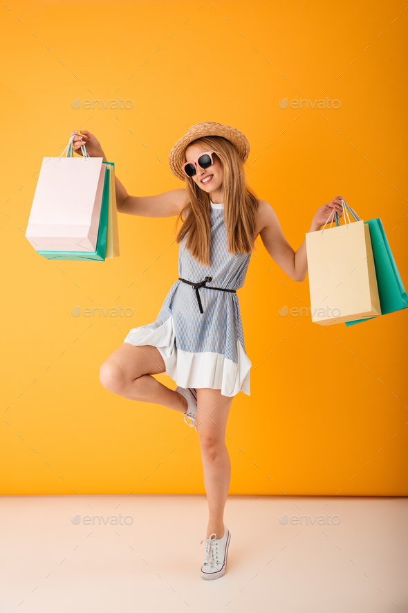 Full length portrait of a cheerful young blonde woman - Stock Photo - Images