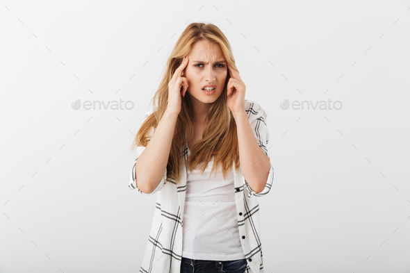 Portrait of an irritated young casual girl suffering - Stock Photo - Images