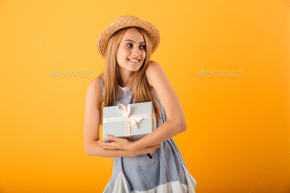 Portrait of a satisfied young blonde woman in summer hat - Stock Photo - Images