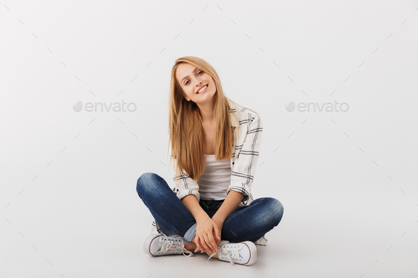 Portrait of cheerful young casual girl - Stock Photo - Images