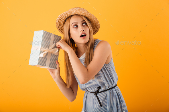 Portrait of an excited young blonde woman in summer hat - Stock Photo - Images
