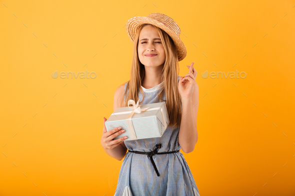 Portrait of a worried young blonde woman in summer hat - Stock Photo - Images