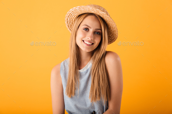Portrait of a smiling young blonde woman in summer hat - Stock Photo - Images
