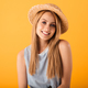 Portrait of a smiling young blonde woman in summer hat - PhotoDune Item for Sale