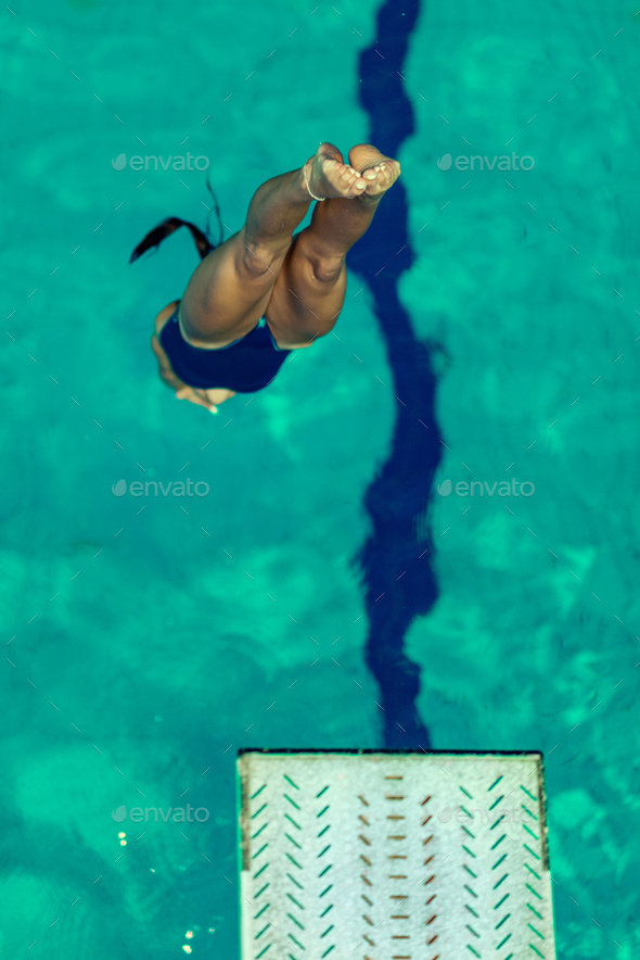 Female diver jumping into the pool - Stock Photo - Images
