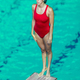 Female diver standing on the jumping board. - PhotoDune Item for Sale