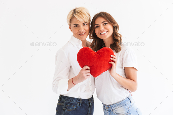Beautiful young lady standing with her mother - Stock Photo - Images