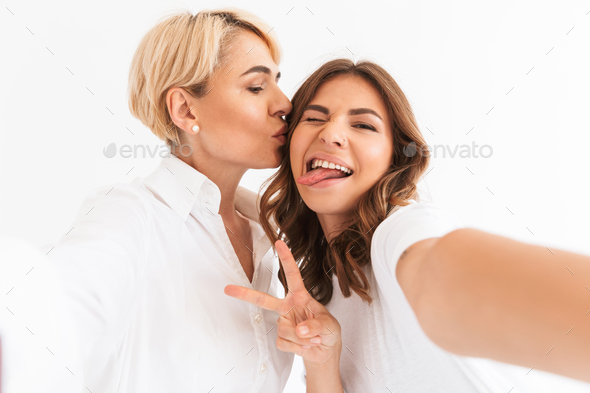 Beautiful young lady take a selfie with her mother - Stock Photo - Images