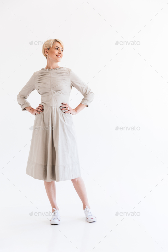 Full length portrait of charming blond adult woman 40s wearing d - Stock Photo - Images