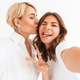 Beautiful young lady take a selfie with her mother - PhotoDune Item for Sale