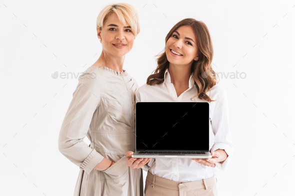 Happy woman with her mother using laptop computer - Stock Photo - Images