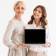 Happy woman with her mother using laptop computer - PhotoDune Item for Sale