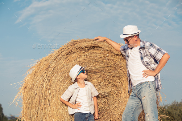 Father and son playing in the park at the day time. - Stock Photo - Images