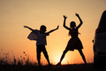 Happy children playing in the park at the sunset time. - PhotoDune Item for Sale