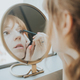 Woman Putting on Makeup in the Mirror - PhotoDune Item for Sale