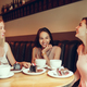 Two girl friends spend time together drinking coffee in the cafe, having breakfast and dessert. - PhotoDune Item for Sale
