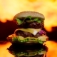 Burger on the Black Mirror Surface The Flame of Grill on the Background Out of Focus - VideoHive Item for Sale