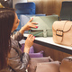 Female customer purchasing new handbag in shop - PhotoDune Item for Sale
