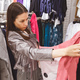 Young woman is buying a pink stripe suit. - PhotoDune Item for Sale