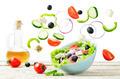 Greek Salad with flying ingredients to prepare it - PhotoDune Item for Sale