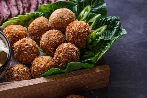 Falafel balls on a romano leafs in a wooden box - Stock Photo - Images