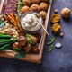 Close view of assorted meze appetizers beef, falafel, babaghanoush, potatoes in a box, copyspace. - PhotoDune Item for Sale