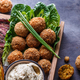 Close view of falafel, babaghanoush and pastrami in the wooden box, copyspace. - PhotoDune Item for Sale