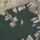 Sea Boat Floating in Parking Lot in Sea Port Between Ships and Yachts Drone View - VideoHive Item for Sale