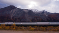 The Trans-Alaska Pipeline Passes in front Of Mountains and Tundra - PhotoDune Item for Sale
