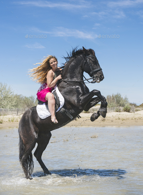 riding girl on the beach - Stock Photo - Images