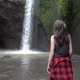 Hiker Woman Exploring Waterfall in Forest. Female Trekking in Bali - VideoHive Item for Sale
