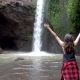 Woman Raise Hands Standing Near Waterfall in Bali - VideoHive Item for Sale