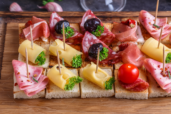 Close view pintxos, tapas, spanish canapes party finger food - Stock Photo - Images