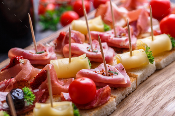 Pintxos, tapas, spanish canapes party finger food background. - Stock Photo - Images