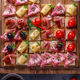 Close view of tiny bruschettas with prosciuto, ham and cheese - PhotoDune Item for Sale