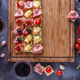 Board full of pinxtos or tapas with jamon, ham and cheese, copyspace - PhotoDune Item for Sale
