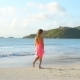 Sihouette of Little Girl Walking on the Beach at Sunset - VideoHive Item for Sale