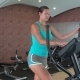 Girl Has an Elliptical Exerciser at the Gym - VideoHive Item for Sale