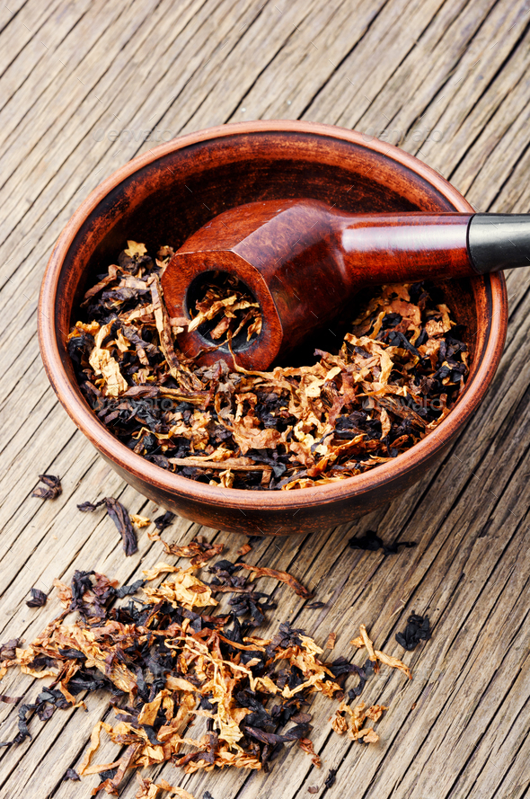 Cognac and pipe with tobacco - Stock Photo - Images